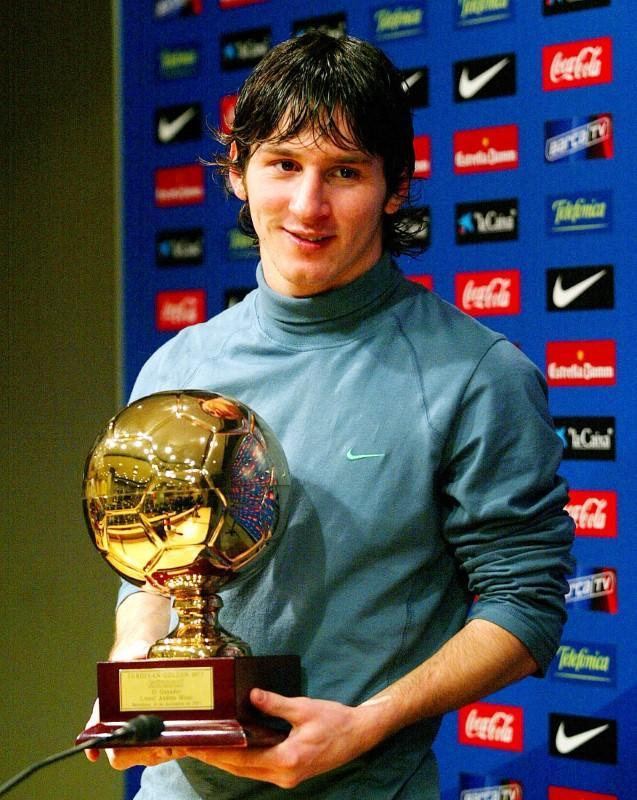 Barcelona's Messi from Argentina poses with Golden Boy trophy in Barcelona