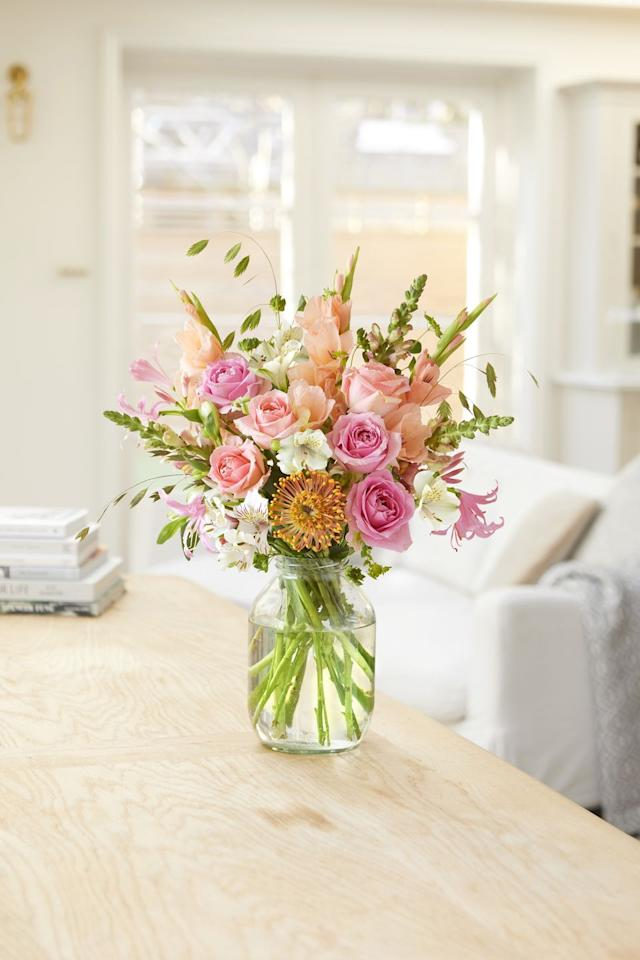 "<p>Pretty in pink, these gorgeous flowers (24 stems in total) include bright roses, peach gladoli, snaps, a leucospermum stem and more. We'd pop these on the dining table in a clear vase.</p><p>Bloom & Wild says: 'As artistic as her namesake, Frida comes in bud and opens into a palette of pink and peach blooms. Gladioli? Check. Roses? Check. Amazing scent? Check.'</p><p><a class=""body-btn-link"" href=""https://go.redirectingat.com?id=127X1599956&url=https%3A%2F%2Fwww.bloomandwild.com%2Fsend-flowers%2Fbouquet%2Fthe-frida&sref=https%3A%2F%2Fwww.housebeautiful.com%2Fuk%2Fgarden%2Fplants%2Fg33409082%2Fbloom-wild-flowers%2F"" target=""_blank"">SHOP NOW</a></p>"