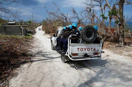A pick up truck with U.N. peacekeepers patrol an area affected by Hurrican Matthew in Jeremie