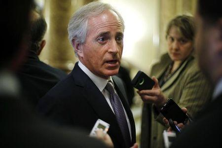 Corker speaks with reporters after Democratic and Republican party policy luncheons at the U.S. Capitol in Washington