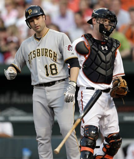 Pittsburgh Pirates' Neil Walker, left, tosses his bat after striking out swinging to end the top of the third inning of a baseball game against the Baltimore Orioles in Baltimore, Wednesday, June 13, 2012. At right is Orioles catcher Matt Wieters. (AP Photo/Patrick Semansky)