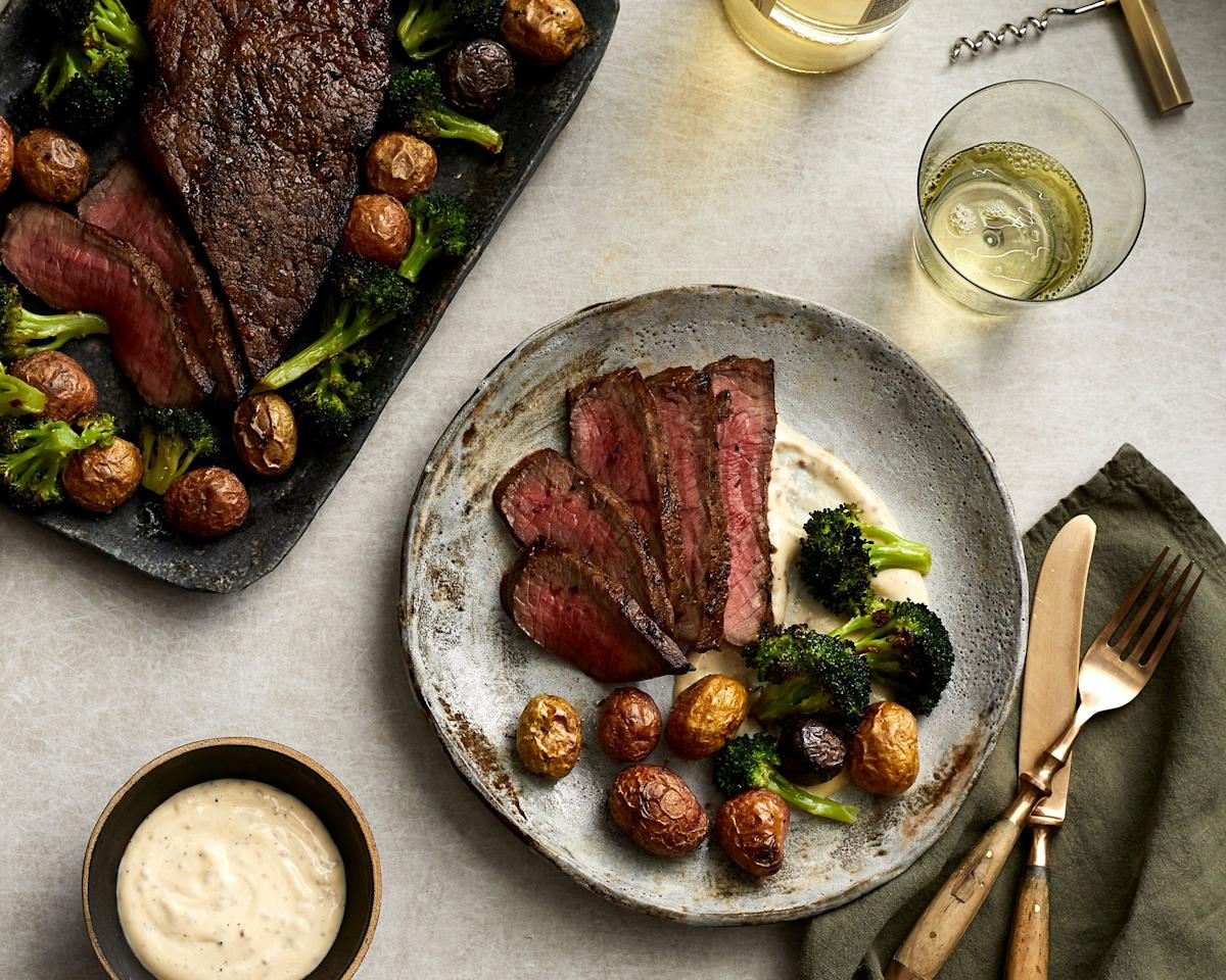 """<p>This sheet pan dinner couldn't be easier (or more delicious), and utilizing inexpensive London broil, it's one you'll come back to again and again. Serving this budget-friendly dinner with a shortcut aioli takes the entire meal up a notch with minimal effort. In testing, we even found that using jarred roasted garlic, rather than preparing your own, absolutely delivers on flavor. London broil will be labeled as such in many supermarkets, but you can also substitute flank steak or top round. </p> <p><a href=""""https://www.myrecipes.com/recipe/London-broil-roasted-garlic-aioli"""">Marinated London Broil with Potatoes, Broccoli, and Roasted Garlic Aioli Recipe</a></p>"""