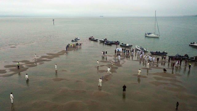 Members of the Royal Southern Yacht Club and the Island Sailing Club during the annual Brambles cricket match between the clubs, which takes place on the Bramble Bank sandbank in the middle of the Solent at low tide (Steve Parsons/PA)