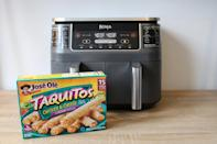 <p>First, grab your taquitos (any frozen brand will do), and preheat your air fryer to 400 degrees for about five minutes. </p>
