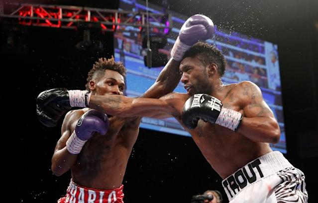 Austin Trout (R) trades punches with Jermall Charlo during their May 2016 bout. (AFP Photo/Steve Marcus)