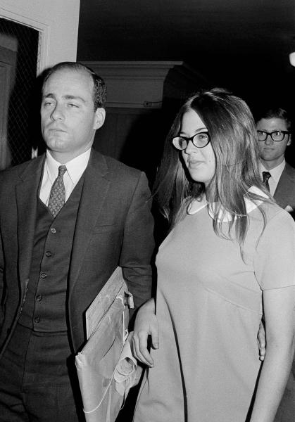 "FILE - In this Sept. 23, 1970 file photo, Barbara Hoyt, 19, former member of Charles Manson's hippie ""family"" arrives at court to testify as a prosecution witness in the Tate-La Bianca murder trial in Los Angeles. On Aug. 9, 1969, two naive 17-year-olds were launched on a path toward the most unlikely of friendships. That infamous night four young people under the sway of a charismatic career criminal slipped into a home in a neighborhood of Hollywood glitterati, then bludgeoned and stabbed rising young actress Sharon Tate, her friend and coffee heiress Abigail Folger, and two others. (AP Photo/Wally Fong, File)"