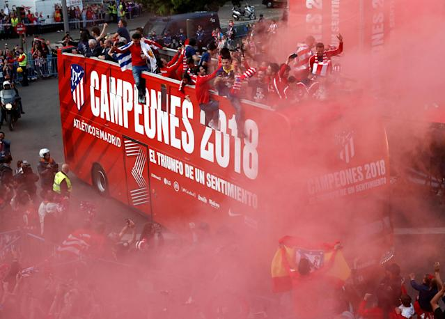 Soccer Football - Atletico Madrid Celebrate Winning The Europa League - Neptuno Square, Madrid, Spain - May 18, 2018 Atletico Madrid players celebrate on an open top bus during the victory parade REUTERS/Juan Medina