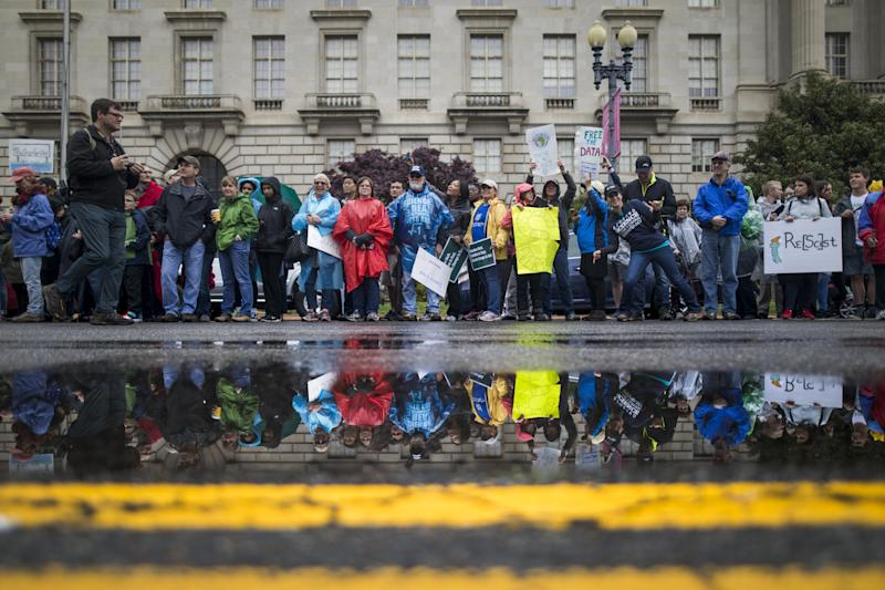 'It's About Facts.' Thousands Protest and Make Friends in the Rain at the March for Science