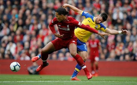 Liverpool v Southampton - Anfield, Liverpool, Britain - September 22, 2018 Liverpool's Virgil van Dijk in action with Southampton's Shane Long - Credit: Phil Noble/Reuters