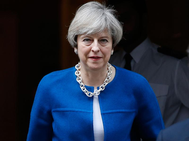 Theresa May leaves 10 Downing Street as the Government reveals its plan to repeal EU laws: AP