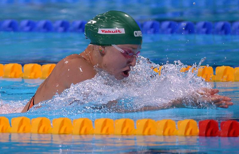 Lithuania's Ruta Meilutyte competes in a Women's 100m breaststroke heat at the FINA Swimming World Championships in Barcelona, Spain, Monday, July 29, 2013 .(AP Photo/Manu Fernandez)