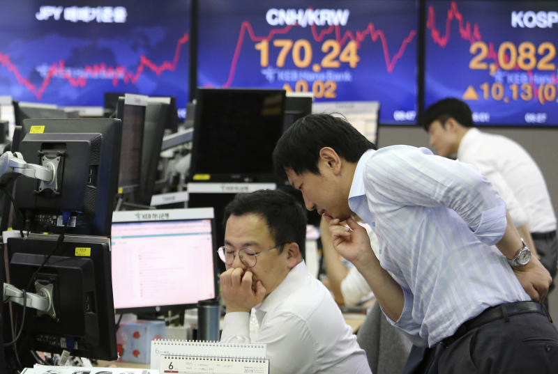 Currency traders work at the foreign exchange dealing room of the KEB Hana Bank headquarters in Seoul, South Korea, Monday, June 10, 2019. Asian financial markets advanced on Monday after China released better-than-expected trade data for May. Gains were reined in by worries over where the world's two largest economies stood on trade negotiations. (AP Photo/Ahn Young-joon)