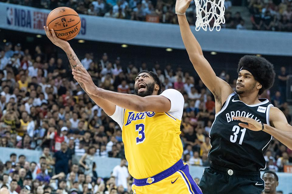 Anthony Davis left Saturday's preseason game against the Nets in China with a sprained thumb. (Getty Images)