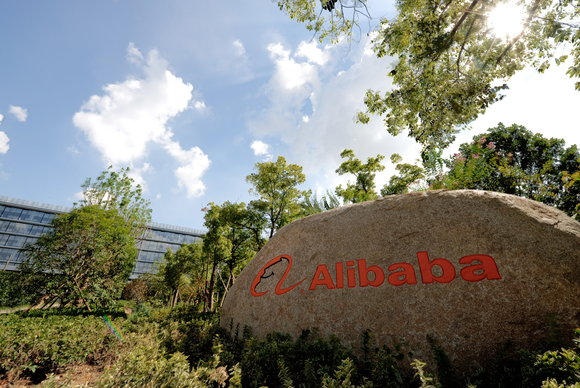 The Alibaba logo is seen in orange lettering on a decorative walk in front of the company's headquarters.