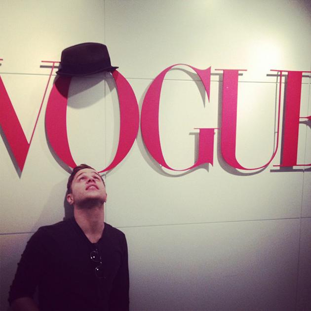 "Celebrity photos: Olly Murs has been loving life in America as he supports One Direction on tour. He made a trip to Vogue HQ and tweeted this image of him next to the Vogue sign, along with the caption: ""O! Where's my hat?"""
