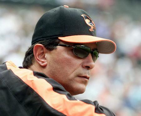 FILE PHOTO: Former Baltimore Orioles manager Lee Mazzilli, shown in this file photo taken during a game at Camden Yards in Baltimore, Maryland May 24, 2005, was fired by the club August 4, 2005. Bench coach Sam Perlozzo was named interim manager replacing Mazzilli. REUTERS/Joe Giza/Files JG/VP