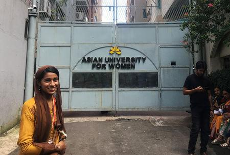Formin Akter, a Rohingya refugee girl, stands outside the gates of the Asian University for Women on her first day of college in Chittagong, Bangladesh August 26, 2018.   REUTERS/Zeba Siddiqui