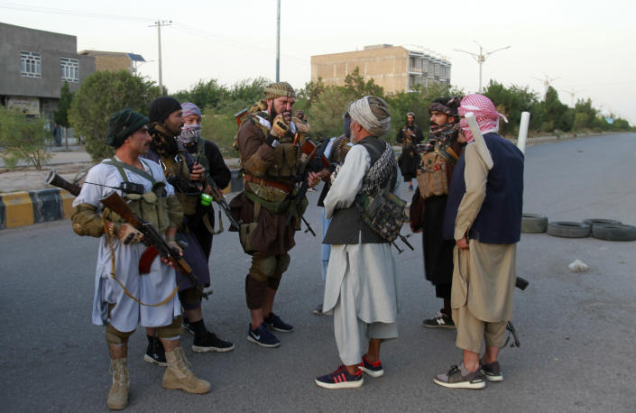 Private militia loyal to Ismail Khan, the former Mujahideen commander, talks with each others and patrols after security forces took back control of parts of Herat city following fighting between Taliban and Afghan security forces in Herat province, west of Kabul, Afghanistan, Friday, Aug. 6, 2021. (AP Photo/Hamed Sarfarazi)