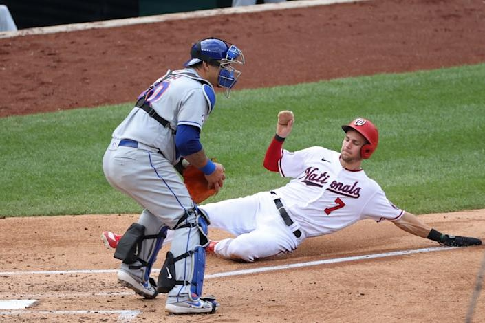 Trea Turner slides into home with Wilson Ramos covering the plate