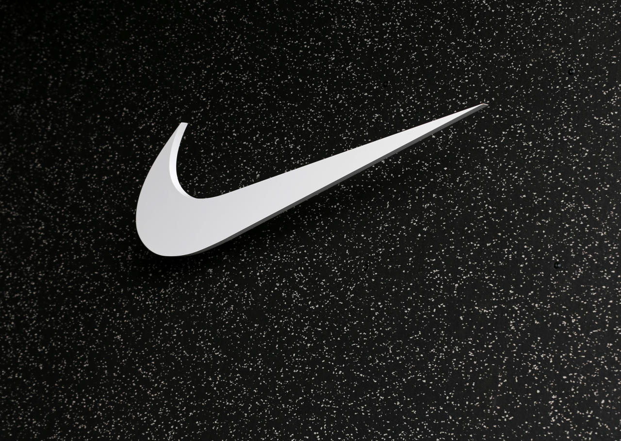 The company logo of Nike is shown at the U.S. Olympic athletics trials in Eugene, Oregon June 21, 2012.  REUTERS/Mike Blake (UNITED STATE - Tags: SPORT BUSINESS LOGO)