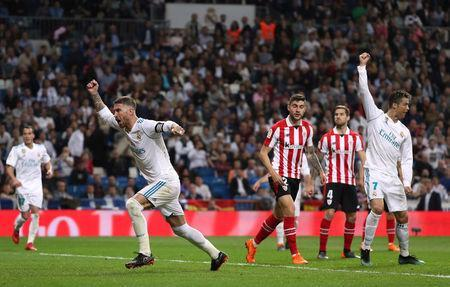 Soccer Football - La Liga Santander - Real Madrid vs Athletic Bilbao - Santiago Bernabeu, Madrid, Spain - April 18, 2018 Real Madrid's Cristiano Ronaldo celebrates scoring their first goal with Sergio Ramos REUTERS/Susana Vera