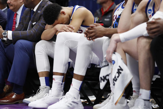 Kansas guard Devon Dotson (11) sits on the bench in the closing minutes of the team's loss to Auburn in a second-round game in the NCAA men's college basketball tournament Saturday, March 23, 2019, in Salt Lake City. (AP Photo/Jeff Swinger)