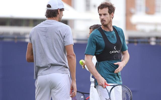 Andy Murray (right) chats with his doubles partner, Feliciano Lopez (left) - Getty Images Europe