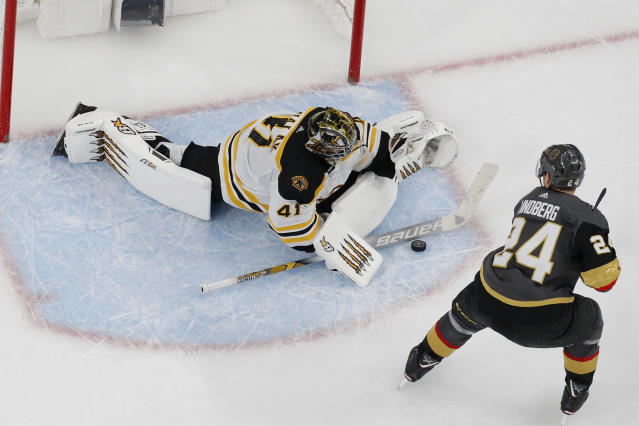 Boston Bruins goaltender Jaroslav Halak (41) blocks a shot by Vegas Golden Knights center Oscar Lindberg (24) during the shootout in an NHL hockey game Wednesday, Feb. 20, 2019, in Las Vegas. (AP Photo/John Locher)