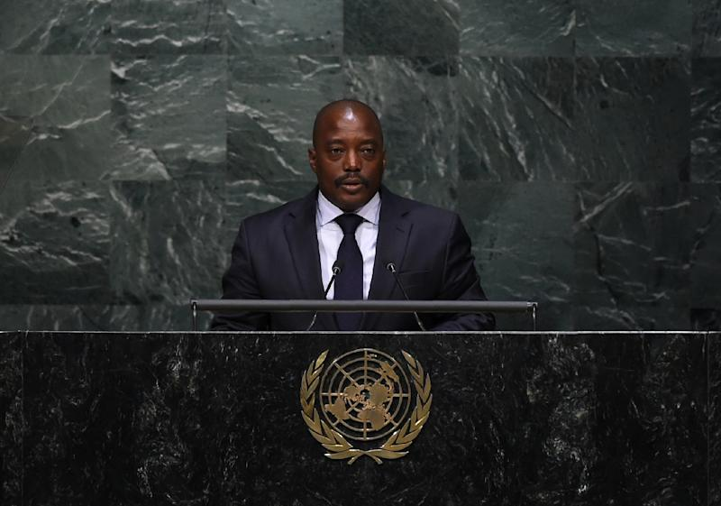 Mediated by the Roman Catholic Church, the accord sketches a timetable under which Democratic Republic of the Congo President Joseph Kabila will stay in office before new elections are held (AFP Photo/JEWEL SAMAD)
