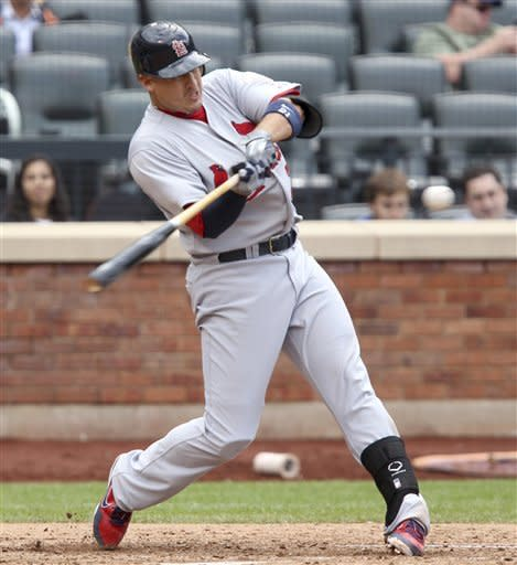 St. Louis Cardinals' Allen Craig hits a two-run homer during the eighth inning of the baseball game against the New York Mets Monday, June 4, 2012, at Citi Field in New York. (AP Photo/Seth Wenig)