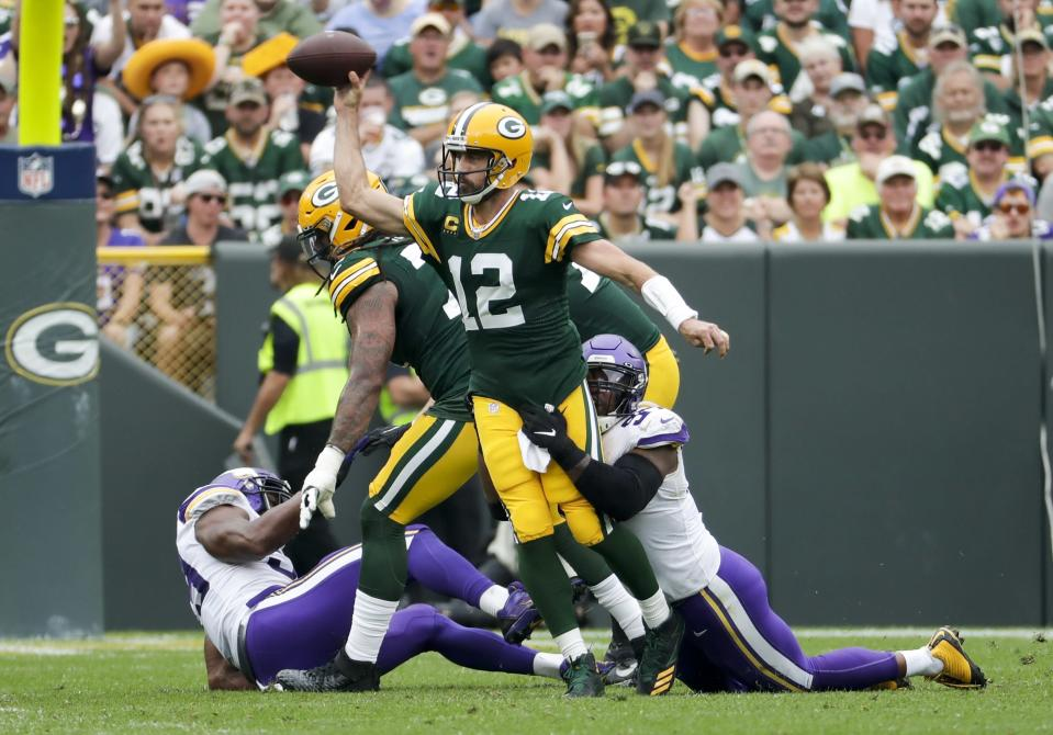 Green Bay Packers' Aaron Rodgers throws as he's hit by Minnesota Vikings' Everson Griffen during the first half of an NFL football game Sunday, Sept. 15, 2019, in Green Bay, Wis. (AP Photo/Morry Gash)
