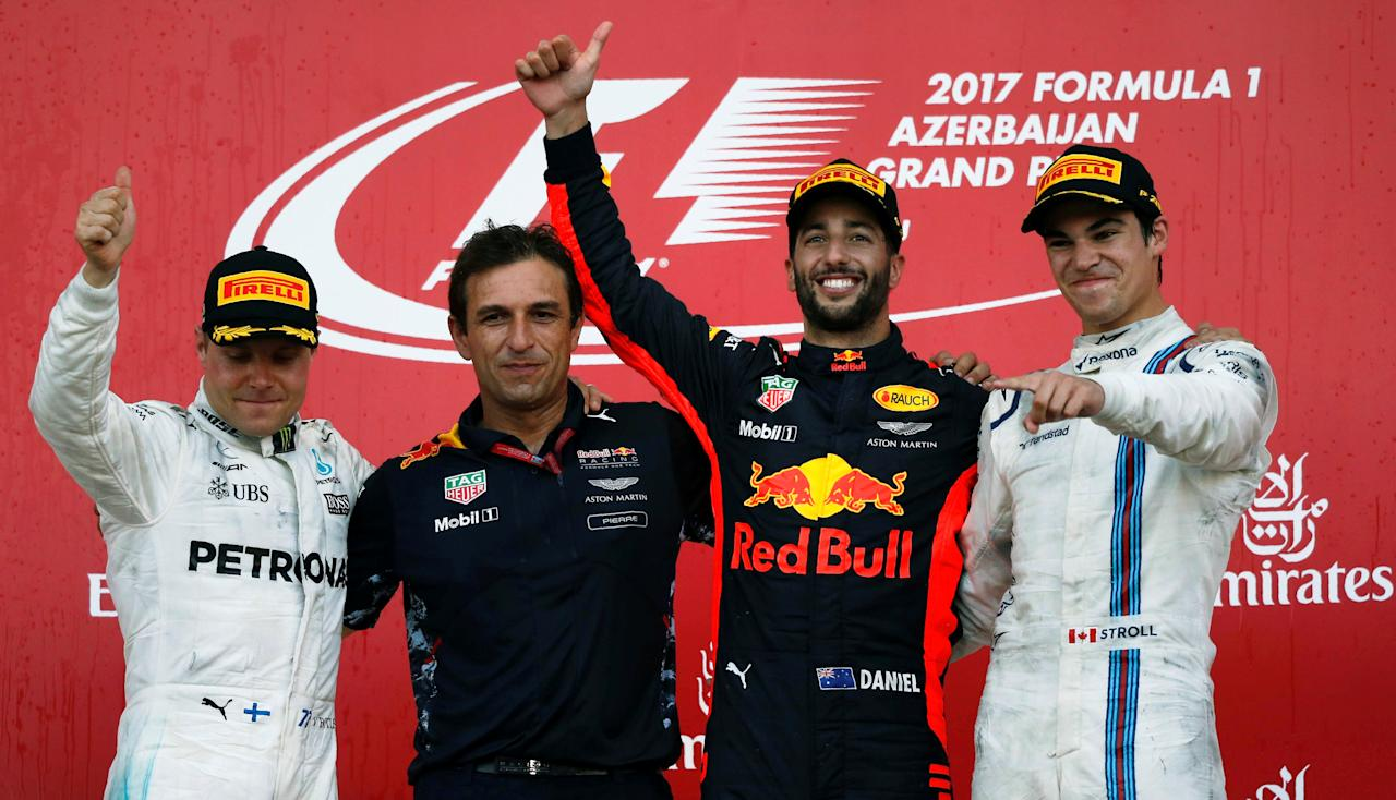 Formula One - F1 - Azerbaijan Grand Prix - Baku, Azerbaijan - June 25, 2017. Red Bull Racing Formula One driver Daniel Ricciardo of Australia, second placed Mercedes' Valtteri Bottas, third placed Williams' Lance Stroll celebrate and Red Bull Racing's chief engineer Pierre Wache celebrate on the podium. REUTERS/David Mdzinarishvili     TPX IMAGES OF THE DAY