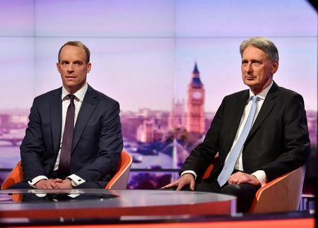 Philip Hammond MP, Chancellor of the Exchequer and Dominic Raab MP, former Brexit Secretary appear on BBC TV's The Andrew Marr Show in London, Britain, May 26, 2019. Jeff Overs/BBC/Handout via REUTERS