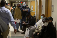 FILE - In this Jan. 23, 2021, file photo, veterans wait in line inside the VA Medical Center in Philadelphia to receive the COVID-19 vaccine during a walk-in clinic. A racial gap has opened up in the nation's COVID-19 vaccination drive, with Black Americans in many places lagging behind whites in receiving shots, an Associated Press analysis shows. (Tyger Williams/The Philadelphia Inquirer via AP, File)