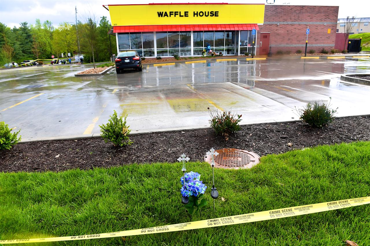 <p>Community members create makeshift memorials for and stop by to pay respects to the victims of the Waffle House shooting on April 24, 2018 in Antioch, Tennessee, where 4 were killed and two were wounded after a gunman entered on April 22. (Photo: Jason Davis/Getty Images) </p>
