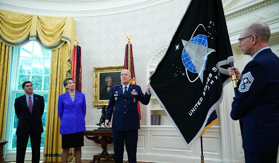 Jay Raymond presents the Space Force flag with former defence secretary Mark Esper, air force secretary Barbara Barrett, and CMSgt Roger Towberman at the White House. Photo: AFP