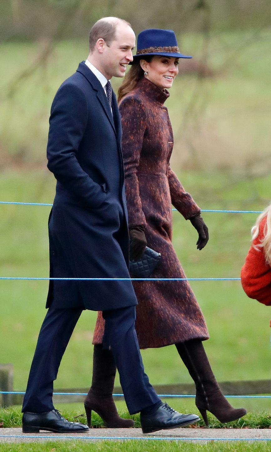 """<p>The Duchess of Cambridge attend Sunday service at the Church of St. Mary Magdalene on the Sandringham estate. She wore a coat, <a href=""""https://www.stuartweitzman.com/home/"""" rel=""""nofollow noopener"""" target=""""_blank"""" data-ylk=""""slk:Stuart Weitzman"""" class=""""link rapid-noclick-resp"""">Stuart Weitzman</a> boots, Jaeger bag, and a fedora by Hicks & Brown.</p>"""