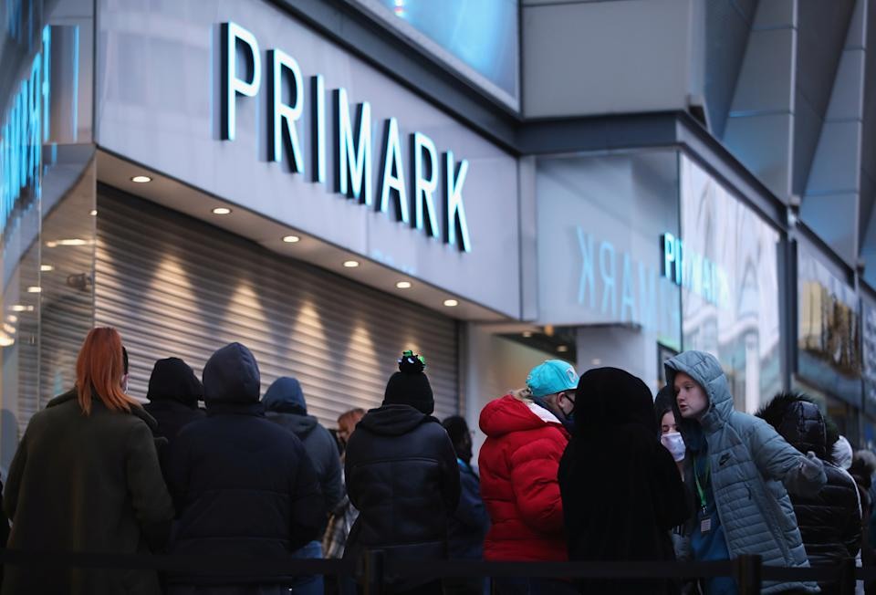 Customers queue to enter as retail store Primark in Birmingham, Britain reopens its doors after a third lockdown imposed in early January due to the ongoing coronavirus disease (COVID-19) pandemic, April 12, 2021. REUTERS/Carl Recine