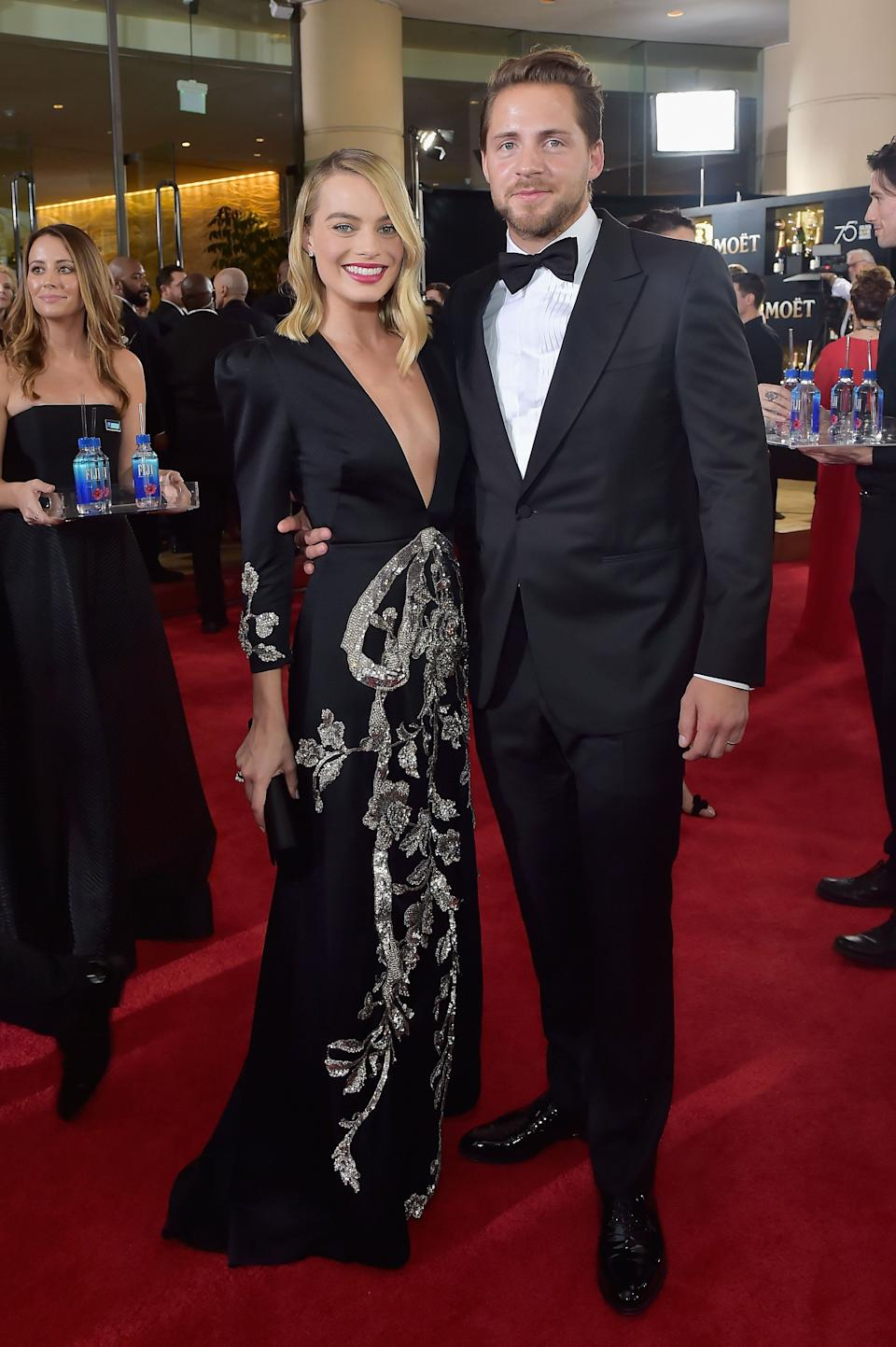 "Margot Robbie secretly tied the knot with producer and screenwriter Tom Ackerley in December 2016 <a href=""https://people.com/movies/margot-robbie-maries-tom-ackerley-reports/"" target=""_blank"" rel=""noopener noreferrer"">in a private ceremony</a> in Austraila's Byron Bay. <br /><br><br><br />In an interview last November with PORTER magazine, the ""Suicide Squad"" actress opened up about how marriage had changed her for the better.<br /><br><br><br />""Being married is actually the most fun ever,"" <a href=""https://people.com/movies/margot-robbie-being-married-most-fun-ever/"" target=""_blank"" rel=""noopener noreferrer"">Robbie said</a>. ""Life got way more fun somehow. I have a responsibility being someone's wife, I want to be better."""