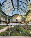 """<p>Creative Director Virginie Viard transformed the Grand Palais into a garden inspired by the garden of the Cistercian monastery in Aubazine named Aubazine Abbey. </p><p><a href=""""https://www.instagram.com/p/B7k4ooCCqKf/"""" rel=""""nofollow noopener"""" target=""""_blank"""" data-ylk=""""slk:See the original post on Instagram"""" class=""""link rapid-noclick-resp"""">See the original post on Instagram</a></p>"""