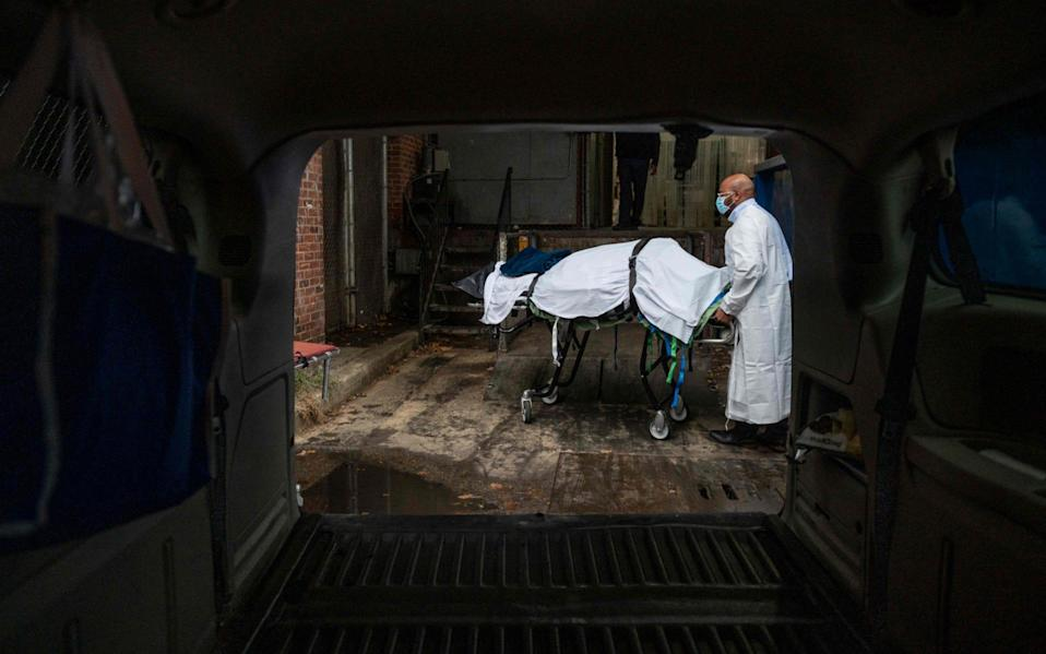 A Covid-19 victim is transported from a hospital morgue in Baltimore, Maryland - ANDREW CABALLERO-REYNOLDS/AFP