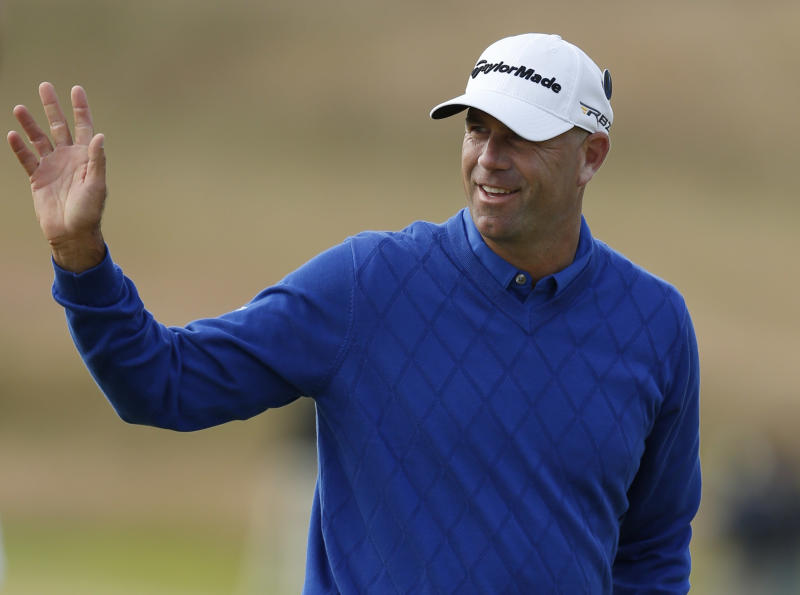 Stewart Cink of the United States reacts after his birdie on the second green during the first round of the British Open Golf Championship at Muirfield, Scotland, Thursday July 18, 2013. (AP Photo/Matt Dunham)