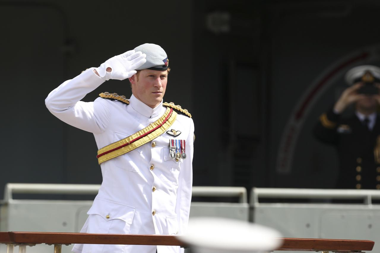 Britain's Prince Harry salutes the troops at Garden Island during the International Fleet Review (IFR) in Sydney October 5, 2013. The review is being held to commemorate the centenary of the first entry of the Royal Australian Navy's Fleet into Sydney Harbour. The IFR visit marks Prince Harry's first official trip to Australia representing the royal family, local media said. REUTERS/Steve Christo (AUSTRALIA - Tags: ROYALS MILITARY POLITICS)