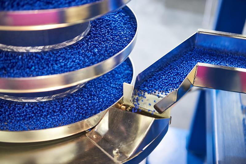 Blue plastic pieces in a manufacturing plant.