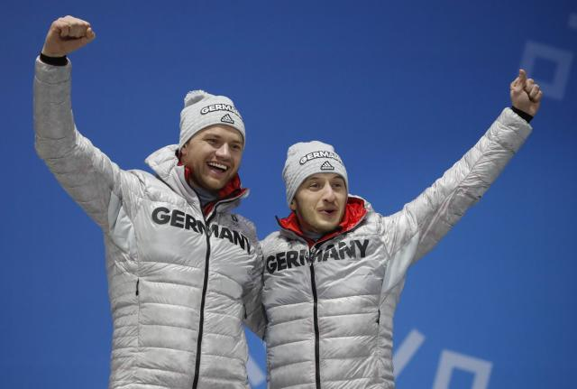 Medals Ceremony - Luge - Pyeongchang 2018 Winter Olympics - Men's Doubles - Medals Plaza - Pyeongchang, South Korea - February 16, 2018 - Bronze medalists, Toni Eggert and Sascha Benecken of Germany on the podium. REUTERS/Kim Hong-Ji