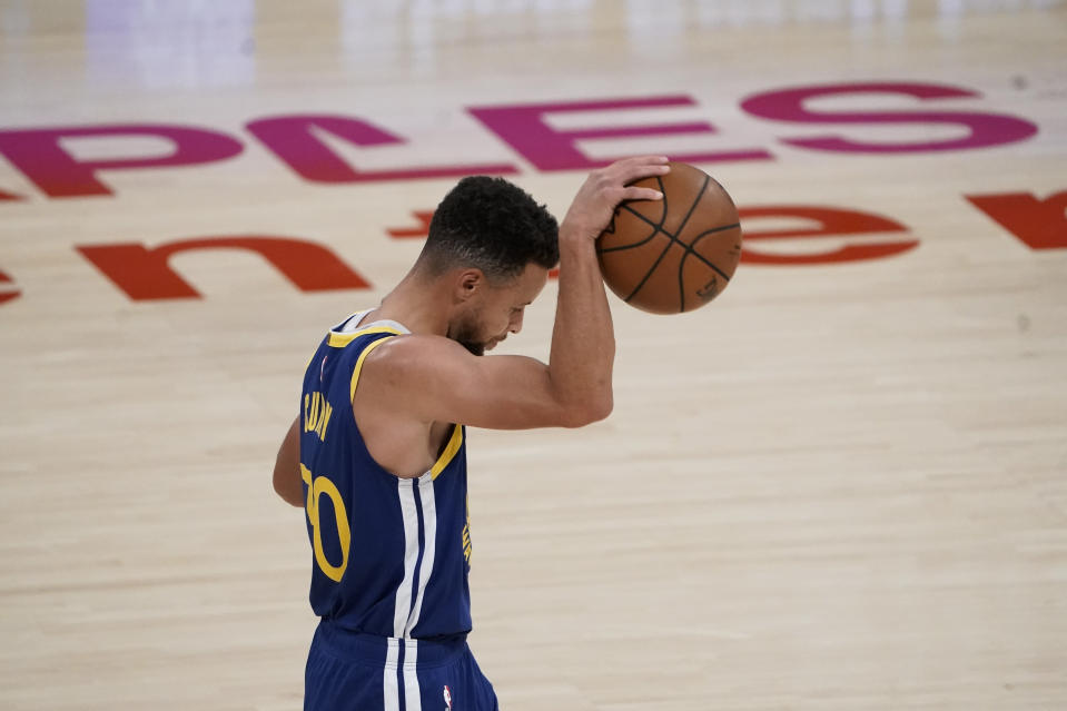 Golden State Warriors' Stephen Curry reacts to a foul call on his team during the first half of an NBA basketball game against the Los Angeles Lakers, Monday, Jan. 18, 2021, in Los Angeles. (AP Photo/Jae C. Hong)
