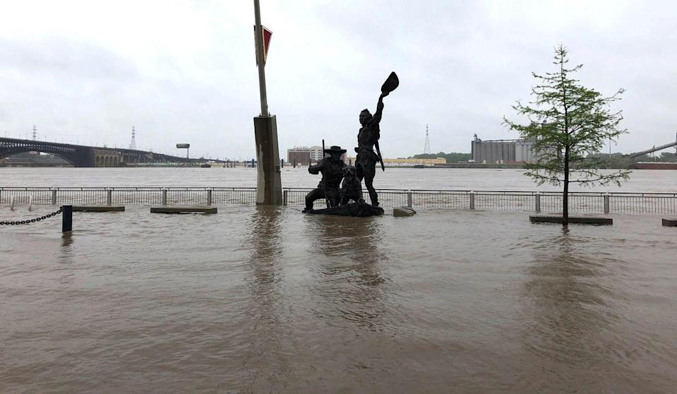 <p>A statue of explorers Lewis and Clark is surrounded by floodwater along the St. Louis riverfront on May 2, 2019.</p>