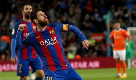 Football Soccer- Spanish La Liga Santander - Barcelona v Osasuna - Camp Nou stadium, Barcelona, Spain - 26/04/17 Barcelona's Lionel Messi celebrates a goal. REUTERS/Albert Gea