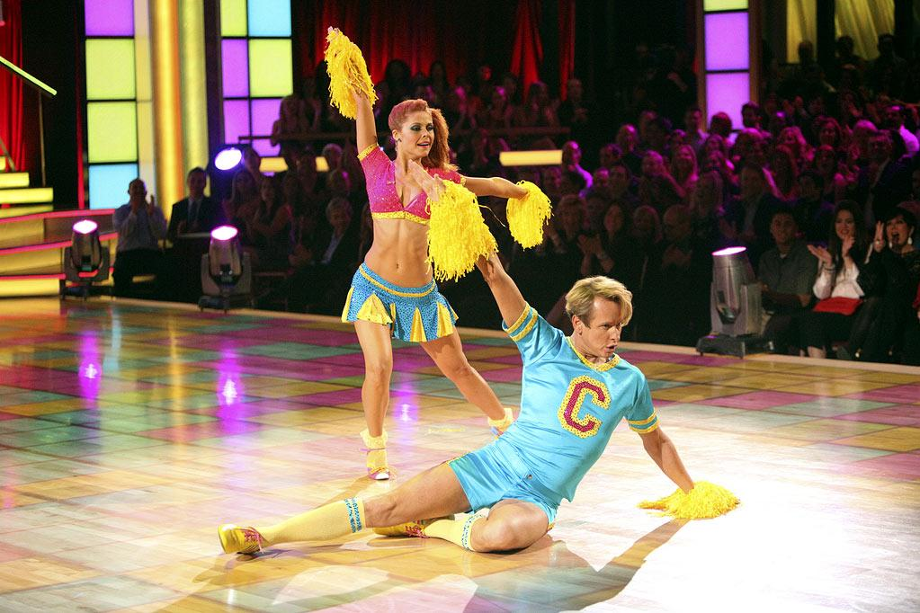 """""""Queer Eye for the Straight Guy"""" alum Carson Kressley channeled his inner varsity cheerleader during the fifth week of the competition by dancing a jive -- with pro partner Anna Trebunskaya -- in shorty shorts, a matching tee, and knee-high socks."""