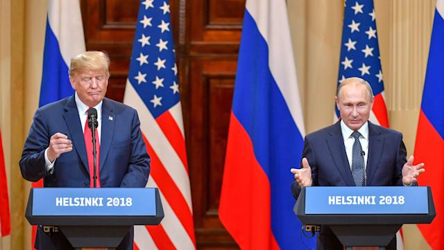 <p>U.S. President Donald Trump and Russia's President Vladimir Putin attend a joint press conference after a meeting at the Presidential Palace in Helsinki, on July 16, 2018. (Photo: Yuri Kadobnov/AFP/Getty Images) </p>